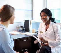 adult woman and doctor talking