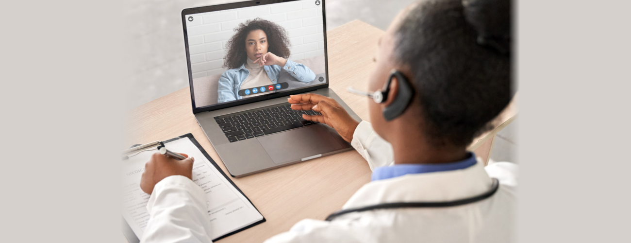 doctor talk to patient by online webcam video call on laptop screen.
